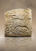 Photo of Hittite relief sculpted orthostat stone panel of Long Wall Limestone, Karkamıs, (Kargamıs), Carchemish (Karkemish), 900 -700 B.C. Anatolian Civilisations Museum, Ankara, Turkey<br /> <br /> Chariot. One of the two figures in the chariot holds the horse's headstall while the other throws arrows. There is a naked enemy with an arrow in his hip lying face down under the horse's feet. It is thought that this figure is depicted smaller than the other figures since it is an enemy soldier. The lower part of the orthostat is decorated with braiding motifs.<br /> <br /> On a brown art background.