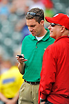 6 March 2012: Washington Nationals Senior Director of Media Relation John Dever checks messages during batting practice prior to a Spring Training game against the Atlanta Braves at Champion Park in Disney's Wide World of Sports Complex, Orlando, Florida. The Nationals defeated the Braves 5-2 in Grapefruit League action. Mandatory Credit: Ed Wolfstein Photo