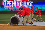 7 April 2016: Member of the Grounds Crew roll out the infield tarp after rains arrive after the first inning during the Washington Nationals Home Opening Game against the Miami Marlins at Nationals Park in Washington, DC. The Marlins defeated the Nationals 6-4 in their first meeting of the 2016 MLB season. Mandatory Credit: Ed Wolfstein Photo *** RAW (NEF) Image File Available ***