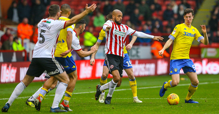 Leeds United's Aapo Halme battles with Sheffield United's David McGoldrick<br /> <br /> Photographer Alex Dodd/CameraSport<br /> <br /> The EFL Sky Bet Championship - Sheffield United v Leeds United - Saturday 1st December 2018 - Bramall Lane - Sheffield<br /> <br /> World Copyright © 2018 CameraSport. All rights reserved. 43 Linden Ave. Countesthorpe. Leicester. England. LE8 5PG - Tel: +44 (0) 116 277 4147 - admin@camerasport.com - www.camerasport.com