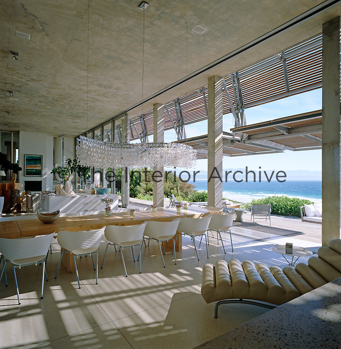 The spectacular living area faces the ocean with shutters which lift away and glass doors which fold out of sight opening the room to the elements