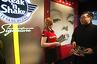 "Hundreds of burger lovers descend on the new Steak 'n Shake Signature restaurant in New York on its grand opening day, Thursday, January 12, 2012. The popular midwest chain opened its first New York outpost with a new concept for the restaurant, a smaller footprint and counter-only service, hence their ""Signature"" branding. Founded in 1934 the company has nearly 500 restaurants with this one in New York being next to the Ed Sullivan Theatre where the Late Show with David Letterman Show is taped. © Richard B. Levine)"