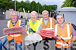 Killarney Tidy Towns members l-r: Donal O'Sullivan, Fr Michael Murphy, Johnny McGuire and Seamus O'Brien working hard cleaning Muckross Road on Monday evening