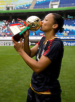 USWNT midfielder (16) Angela Hucles kisses the trophy for most valuable player, the golden ball, after the finals of the Peace Queen Cup.  The USWNT defeated Canada, 1-0, at Suwon World Cup Stadium in Suwon, South Korea.