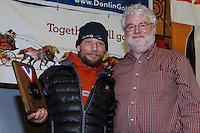 Jason Mackey (L) recieves the ExxonMobil Musher's Choice   award from Russell Tait at the finishers banquet in Nome on Sunday  March 22, 2015 during Iditarod 2015.  <br /> <br /> (C) Jeff Schultz/SchultzPhoto.com - ALL RIGHTS RESERVED<br />  DUPLICATION  PROHIBITED  WITHOUT  PERMISSION