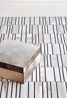 Corridor, a stone mosaic, is shown in Calacatta Tia polished and Montevideo honed.