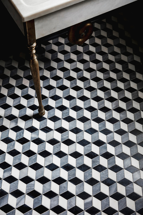 Euclid, a hand-cut mosaic shown in honed Nero Marquina, honed Allure, and polished Dolomite, is part of the Illusions® collection for New Ravenna.<br /> -photo courtesy of House of Brinson