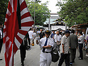 August 15, 2012, Tokyo, Japan - A Japanese carries an ensign during his visit to Tokyo's Yasukuni Shinto Shrine, which honors the war dead, as the nation observes the 67th anniversary of the end of World War II on Wednesday, August 15, 2012. (Photo by Kaku Kurita/AFLO) FYJ -mis-