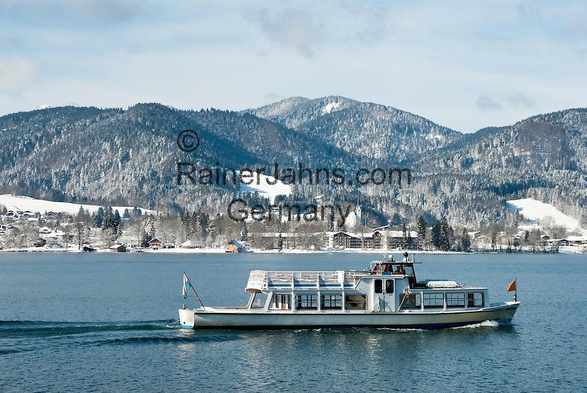 Germany, Bavaria, Upper Bavaria, Tegernseer Valley, Winter at Lake Tegern; sightseeing boat cruising without passengers, background village Abwinkl