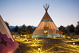 USA, Nevada, Wells, colorful tipis are scattered all over Mustang Monument, A sustainable luxury eco friendly resort and preserve for wild horses, Saving America's Mustangs Foundation