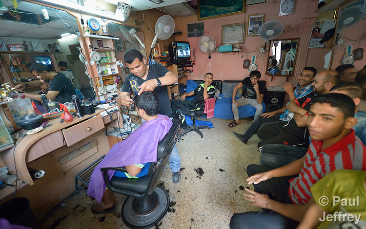 A barber shop in the Zeitoun neighborhood of Gaza City, Gaza. Residents of the Palestinian territory are still reeling from the death and destruction of the 2014 war with Israel, and the continuing siege of the seaside territory by the Israeli military.