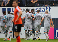 Omar Bogle of Grimsby celebrates scoring his first goal during the Sky Bet League 2 match between Luton Town and Grimsby Town at Kenilworth Road, Luton, England on 10 September 2016. Photo by Harry Hubbard / PRiME Media Images.