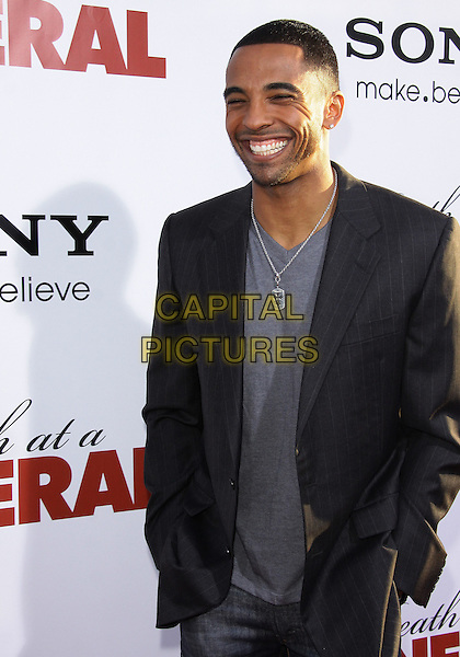 "CHRISTIAN KEYS.Los Angeles Premiere of ""Death At a Funeral""-Arrivals held at The Cinerama Dome, Hollywood, California, USA..April 12th, 2010.half length black jacket grey gray smiling .CAP/ADM/TC.©T. Conrad/AdMedia/Capital Pictures."
