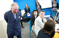 08 March 2016 - London, England - CEO of the Prince's Trust Martina Milburn watches on as Queen Elizabeth II and Prince Charles, Prince of Wales cut a 40th Anniversary cake at the Prince's Trust Centre in Kennington in London. Photo Credit: Alpha Press/AdMedia