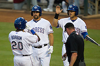 Round Rock Express third baseman Tommy Mendonca #24 and first baseman Mike Bianucci #33 greet outfielder Julio Borbon #20 at home following Borbon's home run during the Pacific Coast League baseball game against the Sacramento River Cats on May 22, 2012 at The Dell Diamond in Round Rock, Texas. The Express defeated the River Cats 11-5. (Andrew Woolley/Four Seam Images)