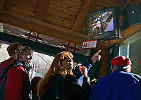 Zoo Atlanta guests watch the giant panda cub on a live video feed during a ceremony to announce the cub's name. ?Mei Lan,? which translates to ?Atlanta Beauty? won in an online poll, receiving 22% of the 57,015 votes cast. Voters were given a list of 10 names from which to choose. The names were suggested by several institutions interested in panda conservation including local media, Zoo Atlanta staff and volunteers, Panda Express (a Zoo Atlanta sponsor) and the people of China.<br />