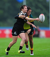Georgie Daals of New Zealand passes the ball. FISU World University Championship Rugby Sevens Women's 9th/10th place match between New Zealand and Australia on July 9, 2016 at the Swansea University International Sports Village in Swansea, Wales. Photo by: Patrick Khachfe / Onside Images
