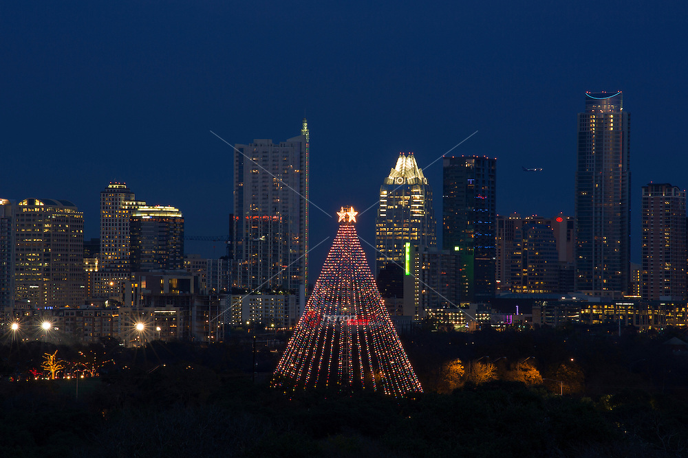 A tradition since 1967, the annual lighting of the Zilker Tree is one of the city's most popular and recognized events...It's not technically a tree but rather one of the original Moonlight Towers (Austin's first illumination system, way back in 1894, consisted of 31 carbon-arc lamps on 150 foot tall wrought iron poles). The Zilker Tree is constructed of 39 streamers which hold 3300 individual bulbs in a spiral design. There is also a large, double star comprised of 150 individual frosted bulbs.