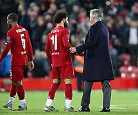 27th November 2019; Anfield, Liverpool, Merseyside, England; UEFA Champions League Football, Liverpool versus SSC Napoli ; Mohammed Salah of Liverpool  shakes hands with SSC Napoli manager Carlo Ancelotti at the end of the match - Editorial Use