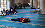 Palestinians take rest at a mosque in Gaza City on the Muslim holy month of Ramadan, on May 21, 2018. Ramadan is sacred to Muslims because it is during that month that tradition says the Koran was revealed to the Prophet Mohammed. The fast is one of the five main religious obligations under Islam. Muslims around the world will mark the month, during which believers abstain from eating, drinking, smoking and having sex from dawn until sunset. Photo by Ashraf Amra