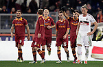 Calcio, Serie A: Roma vs Milan. Roma, stadio Olimpico, 22 dicembre 2012..AS Roma forward Erik Lamela, of Argentina, second from right, celebrates with teammates, from left, Pablo Daniel Osvaldo, Daniele De Rossi, Michael Bradley and Miralem Pjanic, after scoring his second goal, as AC Milan defender Philippe Mexes, of France, right, reacts during the Italian Serie A football match between AS Roma and AC Milan at Rome's Olympic stadium, 22 December 2012.UPDATE IMAGES PRESS/Riccardo De Luca