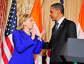 United States President Barack Obama, right, and U.S. Secretary of State Hillary Rodham Clinton, left, share some thoughts at a reception in honor Foreign Minister S.M. Krishna of India (not pictured) at the State Department  in Washington, D.C. on Thursday, June 3, 2010..Credit: Ron Sachs - Pool via CNP