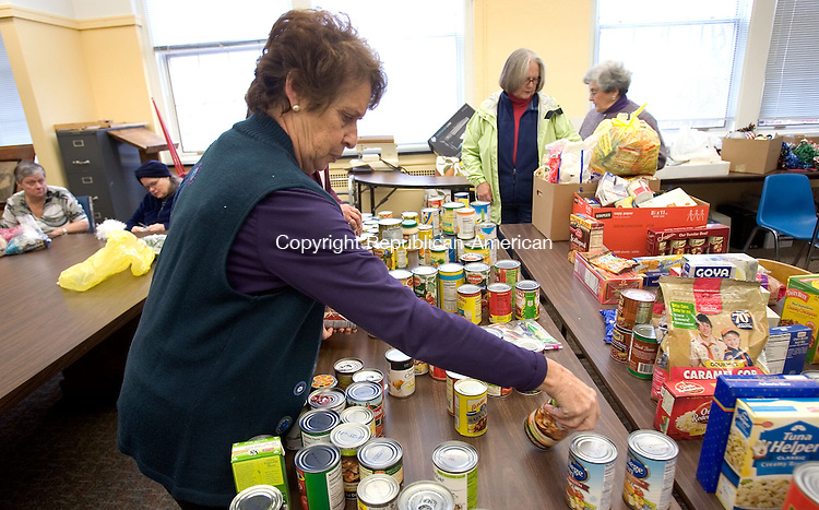 MIDDLEBURY, CT. 16 November 2010-111610SV01--Joann Cappelletti sorts caned goods at the Senior Center in Middlebury Tuesday. Social Services/the Senior Center in Middlebury is collecting turkeys and caned goods for needy families in town before Thanksgiving next week, but the donations are coming in slower than past years. <br /> Steven Valenti Republican-American