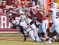 STAFF PHOTO ANTHONY REYES • @NWATONYR<br /> Arkansas running back Alex Collins sheds tackles against Northern Illinois University in the third quarter Saturday, Sept. 20, 2014 at Razorback Stadium in Fayetteville. The Razorbacks won 52-14.