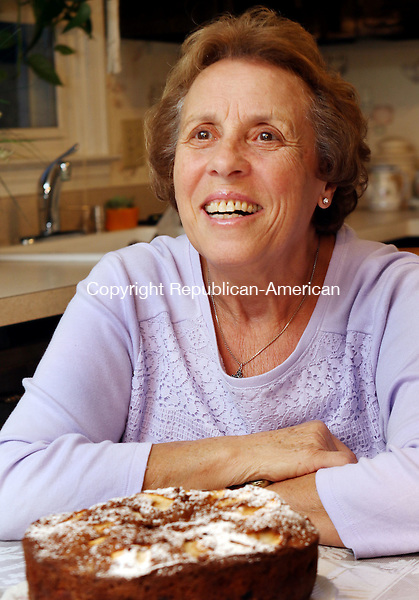 PROSPECT CT. 21 November 2016-112116SV07-Maria Silva sits at a table in her kitchen in Prospect Monday. Silva will appear in Food TV&rsquo;s &lsquo;Clash of the Grandmas&rsquo; which airs December 4th.<br /> Steven Valenti Republican-American
