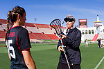 Los Angeles, CA 04/22/16 - An official conducts a pre-game stick check of Greta Meyer (Stanford #5).