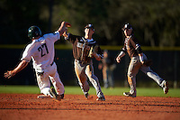 St. Bonaventure Bonnies shortstop Cole Peterson (19) throws to first base as Michael Ketchmark (27) slides in with second baseman Jared Baldinelli (6) backing up the play during a game against the Dartmouth Big Green on February 25, 2017 at North Charlotte Regional Park in Port Charlotte, Florida.  St. Bonaventure defeated Dartmouth 8-7.  (Mike Janes/Four Seam Images)