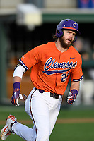 Right fielder Seth Beer (28) of the Clemson Tigers runs out a batted ball in a game against the William and Mary Tribe on February 16, 2018, at Doug Kingsmore Stadium in Clemson, South Carolina. Clemson won, 5-4 in 10 innings. (Tom Priddy/Four Seam Images)
