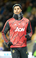 4th January 2020; Molineux Stadium, Wolverhampton, West Midlands, England; English FA Cup Football, Wolverhampton Wanderers versus Manchester United; Marcus Rashford of Manchester United warming up before the match  - Strictly Editorial Use Only. No use with unauthorized audio, video, data, fixture lists, club/league logos or 'live' services. Online in-match use limited to 120 images, no video emulation. No use in betting, games or single club/league/player publications