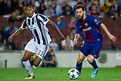12th September 2017, Camp Nou, Barcelona, Spain; UEFA Champions League Group stage, FC Barcelona versus Juventus; Leo Messi of FC Barcelona shields the ball from Alex Sandro of Juventus
