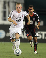 Junior Carreiro #30 of D.C. United chases after Matthew Richie #3 of Portsmouth FC during an international friendly match at RFK Stadium on July 24 2010, in Washington D.C. United won 4-0.