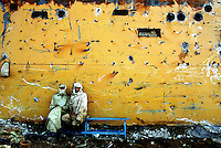 Two workers take a short break while welding inside a ship's hull at the Gaddani ship-breaking yard.