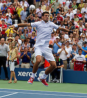 NOVAK DJOKOVIC (SRB) (1) against ROGER FEDERER (SUI) (1) in the Semi-Finals of the Men's SIngles. Novak Djokovic beat Roger Federer 6-7 4-6 6-3 6-2 7-5..Tennis - Grand Slam - US Open - Flushing Meadows - New York - Day 13 - September 10th  2011..© AMN Images, Barry House, 20-22 Worple Road, London, SW19 4DH, UK..+44 208 947 0100.www.amnimages.photoshelter.com.www.advantagemedianetwork.com.