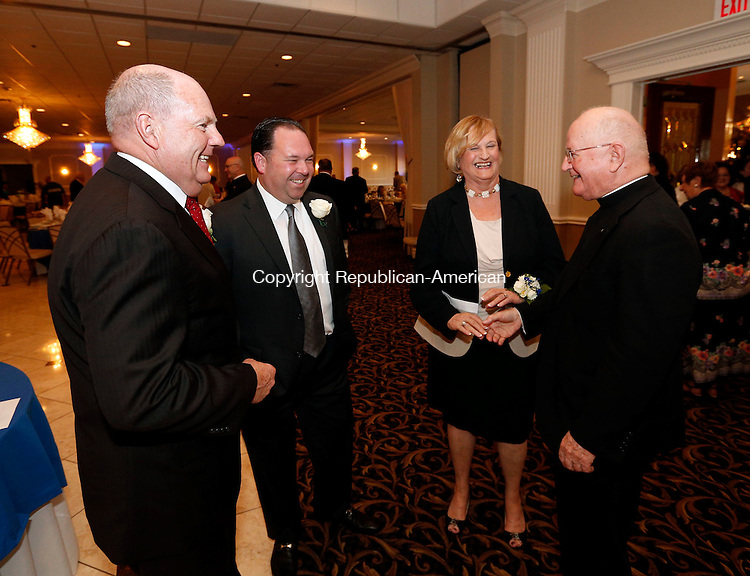 Waterbury, CT- 06 May 2015-050615CM11- From left, honorees  Joe McGrath, recipient of the Spirit of St. Mary Award, John Zinno Jr. recipient of Reverend John P. Blanchfield Community Service Award, Liz Brown, recipient of the Distinguished Alumna Award share a laugh with the Very Rev. John J. Bevins during the annual Bells of Saint Mary fundraising dinner at La Bella Vista in Waterbury on Wednesday evening.  Proceeds from the event will benefit Saint Mary School.   Christopher Massa Republican-American