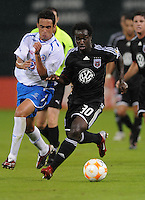 DC United forward Francis Doe (30) keeps possession of the ball while chase by CD Cruz Azul midfielder Gavino Velasco (5). CD Cruz Azul defeated DC United 1-0 ,  in the first leg of the group A of the Concacaf Champions League, Wednesday October 1st, 2008 at RFK Stadium.