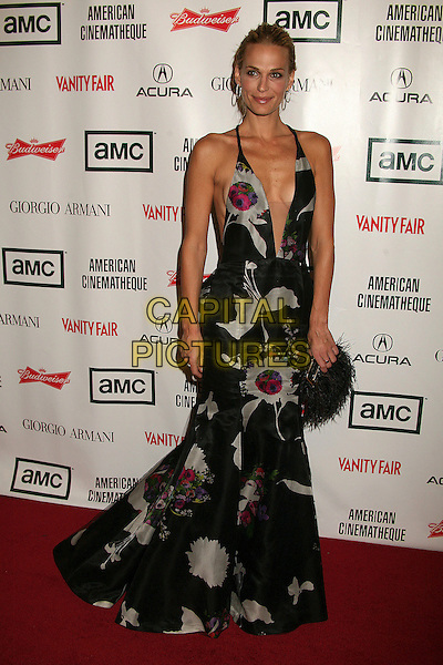 MOLLY SIMS.21st Annual American Cinematheque Award Honoring George Clooney at the Beverly Hilton Hotel - Arrivals, Beverly Hills, California, LA, USA, 13 October 2006..full length long black print patterned dress plunging neckline low cut silver grey fluffy feather bag purse.Ref: ADM/BP.www.capitalpictures.com.sales@capitalpictures.com.©Byron Purvis/AdMedia/Capital Pictures.