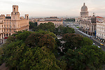 Havana, Cuba; Central Park, the Capitol building and the Gran Teatro in early morning light, viewed from the roof of the Parque Central Hotel