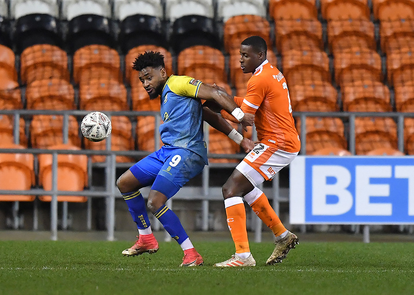 Blackpool's Donervon Daniels is held off the ball by Solihull Moors' Adi Yussuf<br /> <br /> Photographer Dave Howarth/CameraSport<br /> <br /> The Emirates FA Cup Second Round Replay - Blackpool v Solihull Moors - Tuesday 18th December 2018 - Bloomfield Road - Blackpool<br />  <br /> World Copyright © 2018 CameraSport. All rights reserved. 43 Linden Ave. Countesthorpe. Leicester. England. LE8 5PG - Tel: +44 (0) 116 277 4147 - admin@camerasport.com - www.camerasport.com