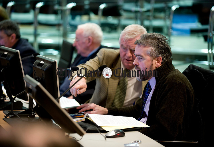 Christy Curtin and Gerry Flynn get to grips with their technology at the first Clare County Council meeting in their new chamber at New Road. Photograph by John Kelly.