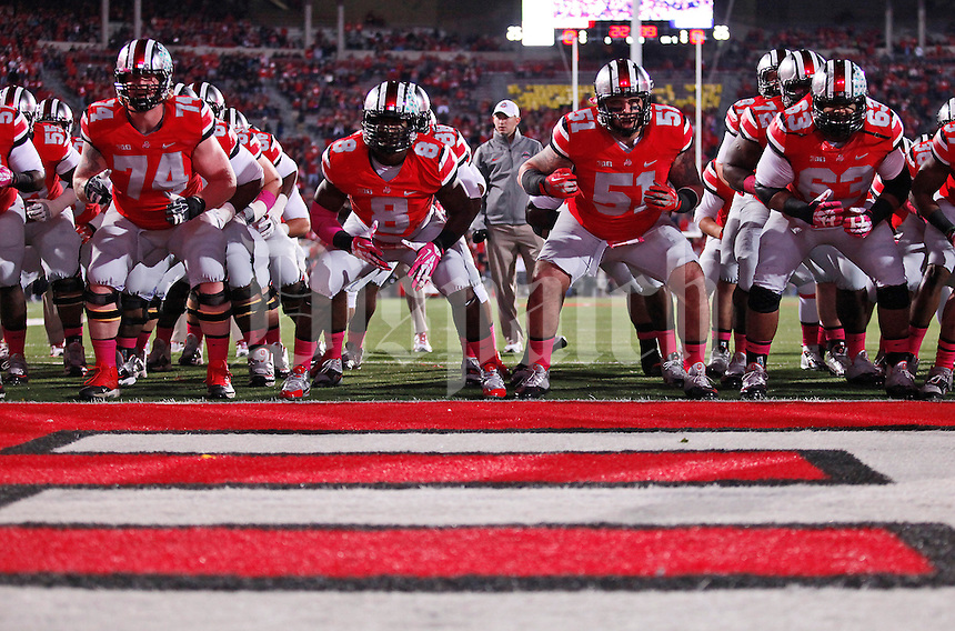 Ohio State players do the Quick Cal drill prior to the NCAA football game against Penn State at Ohio Stadium in Columbus on Oct. 26, 2013. (Adam Cairns / The Columbus Dispatch)
