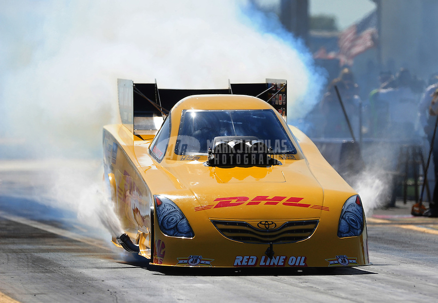 Sept. 23, 2011; Ennis, TX, USA: NHRA funny car driver Jeff Arend during qualifying for the Fall Nationals at the Texas Motorplex. Mandatory Credit: Mark J. Rebilas-
