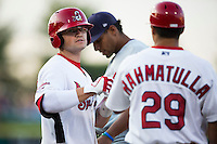 James Ramsey (3) of the Springfield Cardinals bumps fist with Tyler Rahmatulla (29) after getting on base during a game against the Northwest Arkansas Naturals at Hammons Field on August 20, 2013 in Springfield, Missouri. (David Welker/Four Seam Images)