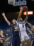 Nevada guard Jalen Harris (2) shoots over Colorado Christian center Spencer Hoffman (40) during the second half of an NCAA college basketball game in Reno, Nev., Wednesday, Oct. 30, 2019.