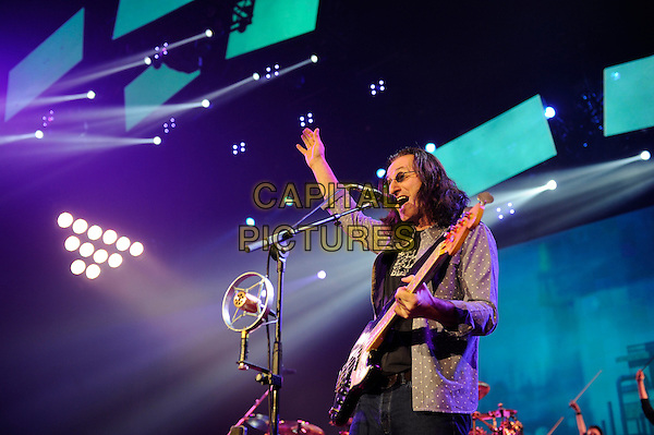 Geddy Lee of Rush.Rush performing in concert, o2 Arena, Greenwich, London, England, UK, 24th May 2013..music live on stage gig performing performance half length guitar playing microphone singing .CAP/MAR.© Martin Harris/Capital Pictures.