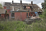 House being demolished, Shottisham, Suffolk, England asbestos roof tiles stacked up for safe removal.