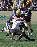 Pitt defensive end Bryan Murphy (93) tackles Gardner-Webb running back Kenny Little (6). The Pitt Panthers defeated the Gardner-Webb Runnin Bulldogs 55-10 at Heinz Field, Pittsburgh PA on September 22, 2012..